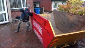 Happy Customer with Skip Outside of his house
