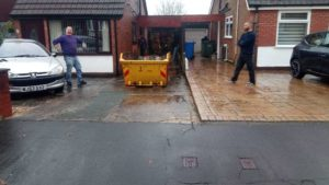 Lostock Skip Placed High Up the Driveway